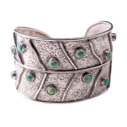 Sterling silver leaf design, turquoise bezel set stones slightly textured oxidized cuff bracelet.
