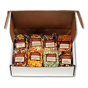 Candy House All Snack Sampler Box Contains: 5 Oz. Cinnaberry Breakfast Blend; 5 Oz. Deluxe Nut Mix; 5 Oz. Classic Trail Mix; 5 Oz. Honey Cheddar Mix; 5 Oz. Wasabi Peas; 5 Oz. Cajun Spicy Mix; 5 Oz. Peanut Colada Mix; 5 Oz. Berries & Nuts Mix. SCS