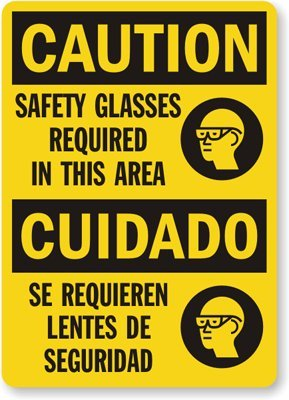 : Safety Glasses Required In This Area, Cuidado Se Requieren Lentes