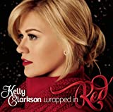 Deluxe Edition of Wrapped in Red includes two bonus tracks: I'll Be Home For Christmas and Oh Come, Oh Come Emmanuel. [US Version 16 Tracks Audio CD] by Kelly Clarkson (with special guests Reba McEntire, Trisha Yearwood, and Ronnie Dunn)