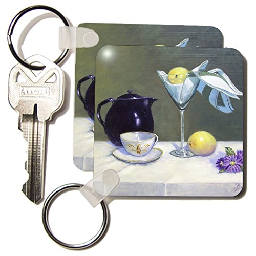 Kc_61492_1 Gladys Bacon Still Life - Beautiful Indigo Tea Pot, Champagne Glass, Bright Lemon, With White And Gold Cup And Saucer - Key Chains - Set Of 2 Key Chains