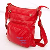 A BRAND NEW, RED LEATHER-LOOK SUPPLE PVC, ZIP-UP SHOULDER BAG c/w A FULLY ADJUSTABLE SHOULDER STRAP