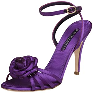 Another purple strappy shoe with rose embellishment and high heel.