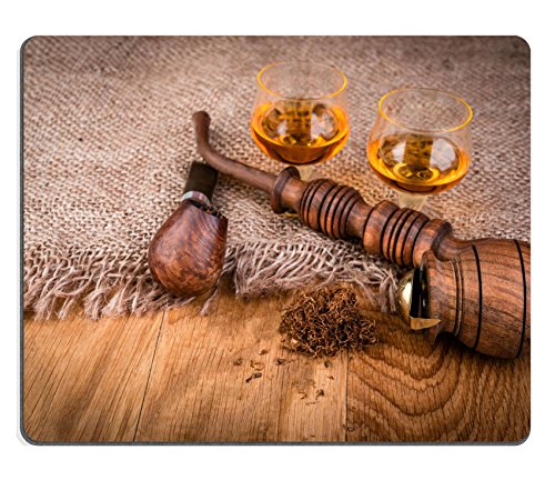 Luxlady Gaming Mousepad IMAGE ID: 34329538 cognac or brandy and smoking pipe on a wooden table vintage style