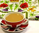 Best of British Union Jack Teacup and Saucer with 50 pound note and Royal Wedding Tea Towels.
