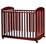 Portable Baby Crib with Casters in Cherry Finish
