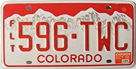 Colorado License Plate with Red numbers on White Mountain