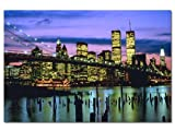 Manhattan skyline against Brooklyn Bridge, New York.Fantastic picture of New York City lit up, with the iconic Twin Towers in the background.
