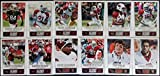 2014 Score Football Arizona Cardinal Team Set In a Protective Case - 12 Cards Including Larry Fitzgerald (2), Patrick Peterson (2), Deone Bucannon RC, Robert Housler, Troy Niklas RC, Michael Floyd, Tyrann Mathieu, Andre Ellington, Logan Thomas RC, and Carson Palmer.