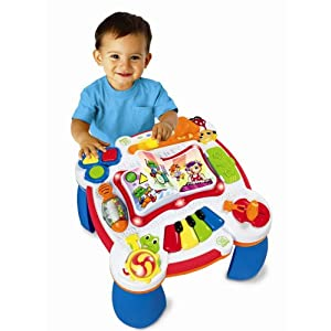 Child playing with learning table