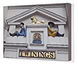 Canvas Print of Two Asian figures and a golden lion above the entrance to the Twinings tea shop