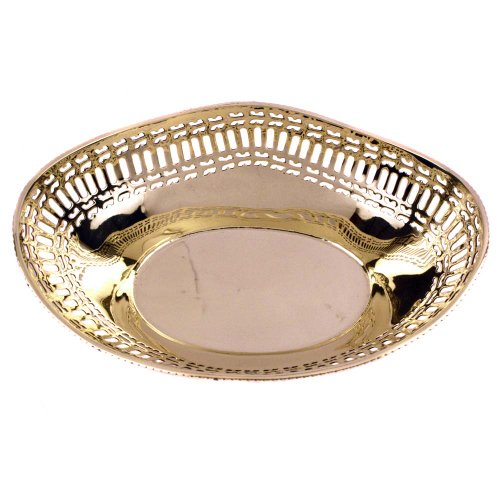 Finely handcrafted boat shaped brass basket with meshed edges as an attractive tableware