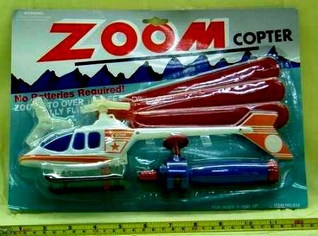 "Pull launcher zoom copter helicopter pull string & watch it zoom up. 3 asst. colors white, green & black. Each blister carded. (Size 12 1/2"") - color sent at random"