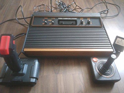 atari-2600-konsole-erstausfuhrung-mit-holz-design