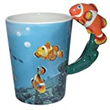 TWO OFF MUGS, ONE WITH A CLOWN FISH HANDLE AND THE OTHER WITH A SHARK HANDLE MAKES A GREAT GIFT FOR A FISH LOVER