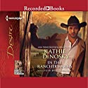 In the Rancher's Arms: Rich, Rugged Ranchers, Book 4 Audiobook by Kathie Denosky Narrated by Brian Hutchison