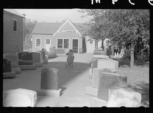 Photo Girl playing among tombstones, Lexington, Nebraska 1938