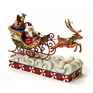 Click to buy Musical Christmas Lights: Jim Shore Heartwood Creek Santa Musical Lighted Masterpiece Santa in Sleigh with Flying Reindeer Figurine 10-1/2-Inch from Amazon!