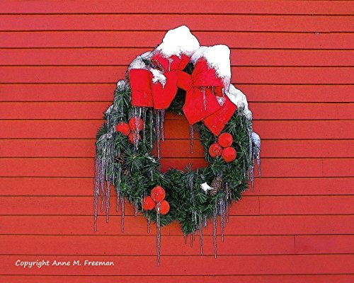 Winter Wreath. A fine art photograph of a Christmas wreath with ice cycles and snow. Bright red winter holiday!