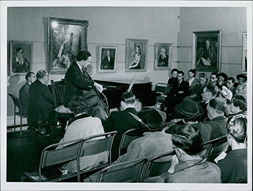 vintage-photo-of-people-gathered-in-a-musical-program-in-usher-art-gallery