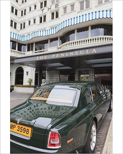 photographic-print-of-the-peninsula-hotel-and-one-of-the-hotel-s-fleet-of-green-rolls-royces