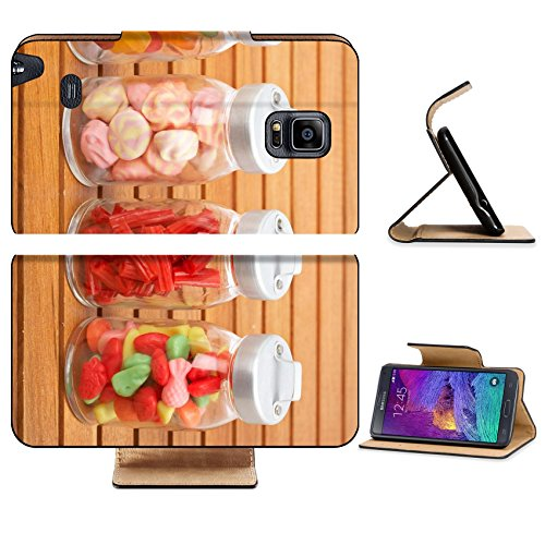Liili Premium Samsung Galaxy Note 4 Flip Pu Leather Wallet Case IMAGE ID: 4268077 Assortment of glass jars with marshmallows candies and red licorice on wooden background Shallow depth of field (Candy Jar Executive compare prices)
