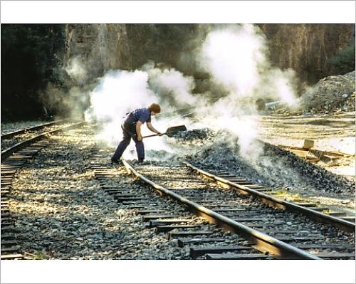 photographic-print-of-shovelling-hot-ashes