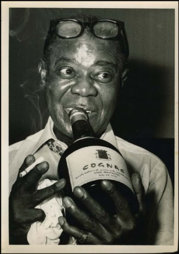 Armstrong, Louis. (1901-1971). Original Photograph Drinking Cognac From The Bottle.
