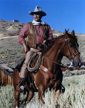 John Wayne and Kirk Douglas on horseback in the 1967 film