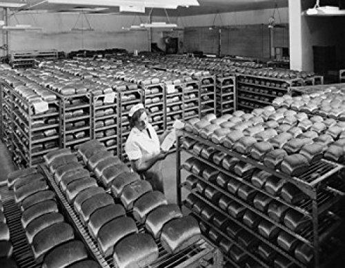 female-worker-examining-bread-in-a-bakery-pepperidge-farm-bakery-norwalk-connecticut-usa-poster-6096