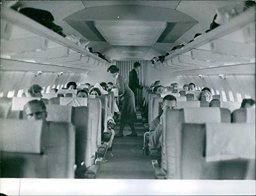 vintage-photo-of-air-hostess-assisting-the-passengers-aboard-a-boeing-airplaneboeing-airplanes-first