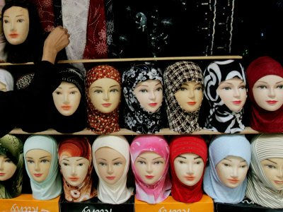 51aI5XB80RL Muslim Women Dress Arab Girl Buys an Islamic Head Dress in Preparation for the Muslim Holy Fasting Month of Ramadan Premium Photographic Poster Print, 42x56