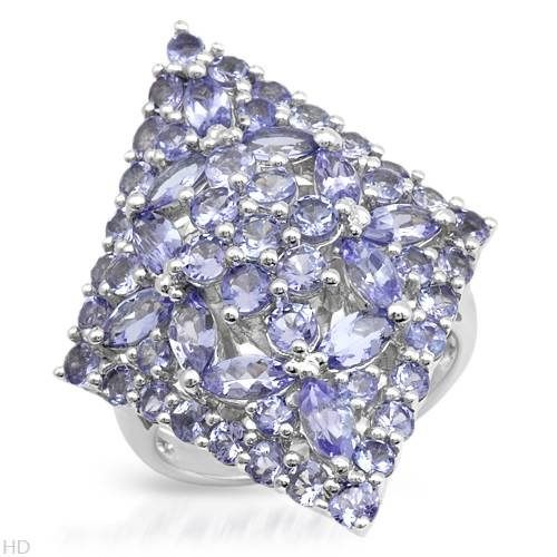 Sterling Silver 4.12 CTW Tanzanite Cocktail Ladies Ring. Ring Size 9. Total Item weight 7.3 g.