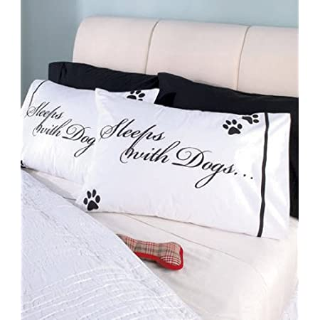"This Dog Lovers ""Sleeps With Dogs"" Pillowcase Set will add a special touch to your bedding. If Fido or Rover share a special place on your bed, why not announce it with these lighthearted pillow cases! White pillowcases with black lettering, stripe a..."