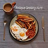 Double Egg With Chips And Beans (And A Tea) by Antique Seeking Nuns (2006-08-03)