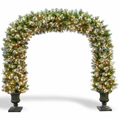 8 1/2 Ft. Wintry Pine Christmas Archway Decoration with Cones, Red Berries and Snowflakes in Dark Bronze Fiberglass Pot with 900 Clear Lights-UL