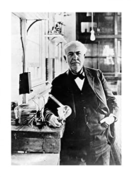 Thomas Edison with the first light bulbs