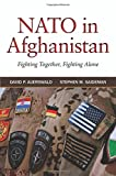 img - for NATO in Afghanistan: Fighting Together, Fighting Alone book / textbook / text book