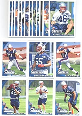 2010 Topps New England Patriots Complete Team Set of 18 cards including Tom Brady, Randy Moss, (2) Wes Welker, rookies of Devin McCourty, Zac Robinson, Jermaine Cunningham, Rob Gronkowski, Brandon Spikes, Taylor Price, Aaron Hernandez and more!