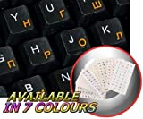 Russian Cyrillic keyboard stickers with orange lettering on transparent background