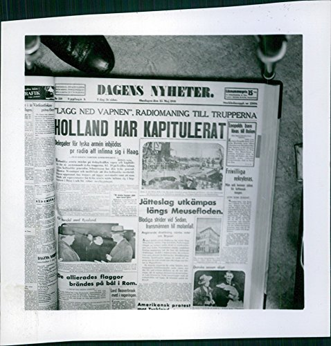 vintage-photo-of-a-news-paper-page-about-the-surrender-of-holland