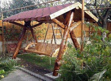 Casa Padrino Garten Schaukel Rustikal überdacht Hollywood Schaukel Mod S1 – Eiche Massivholz – Echtholz Massiv online kaufen