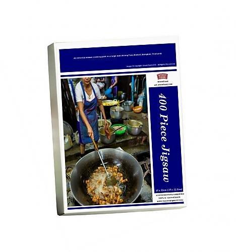 photo-jigsaw-puzzle-of-an-oriental-woman-cooking-pork-in-a-large-wok-klong-toey-market-bangkok