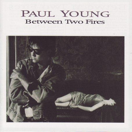 Paul Young - Between Two Fires - Zortam Music
