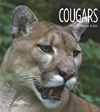 img - for Cougars (Living Wild (Hardcover)) book / textbook / text book