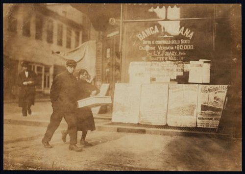 Photo Carrying the flowers back to the factory. Bleeker St., N.Y. Location: New York, New York State 1912