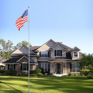 Image of an American flag on a flag pole outside a house.