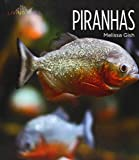 img - for Piranhas (Living Wild (Hardcover)) book / textbook / text book