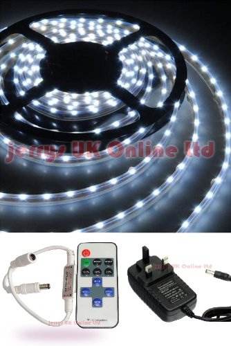 ONE FULL KIT Cool White 5 Metre SMD LED Strip Light + Power Adaptor + FREE Remote Flasher Control. Ideal for Child Rooms, Kitchens, Cabinets, Displays, Gardens, Homes, Bars, Aquariums, Cars, Christmas, Halloween . Comes with Self Adhesive Strip.
