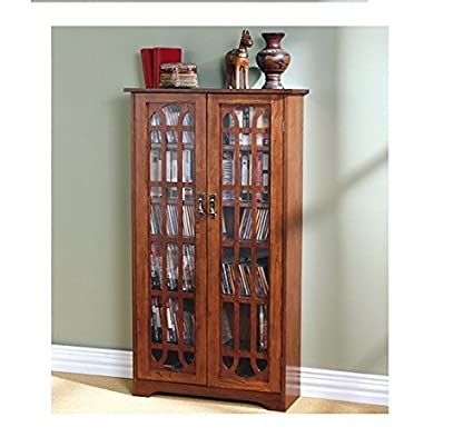 Safely Store Your Favorite Dvds on a 6-shelf Entertainment Cabinet with Media Glass Paneled Holder Made with Oak Wood That Has Double-doors for Opening Design. This Item Is Great for Storing Books, Collectibles, Keepsakes and Much More.